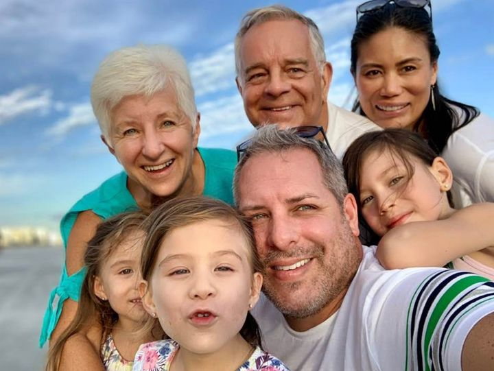 Mike Maloney and Sheila Golez and their kids, just reunited with Mike's parents to create a two-household double bubble.