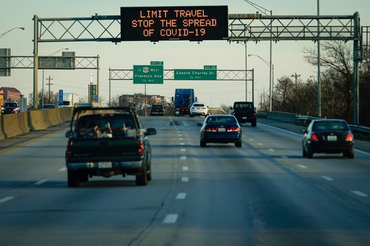 A highway sign on Interstate 75 advises travelers to limit travel in order to slow the spread of the novel coronavirus (COVID