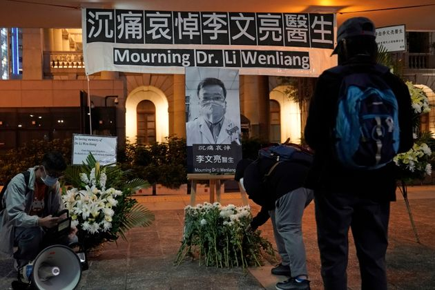 People in Hong Kong attend a vigil on Feb. 7, 2020 for Chinese doctor Li Wenliang, who died of COVID-19...