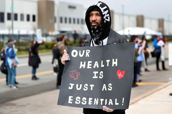 Former Amazon employee, Christian Smalls, stands with fellow demonstrators during a protest outside of an Amazon warehouse as
