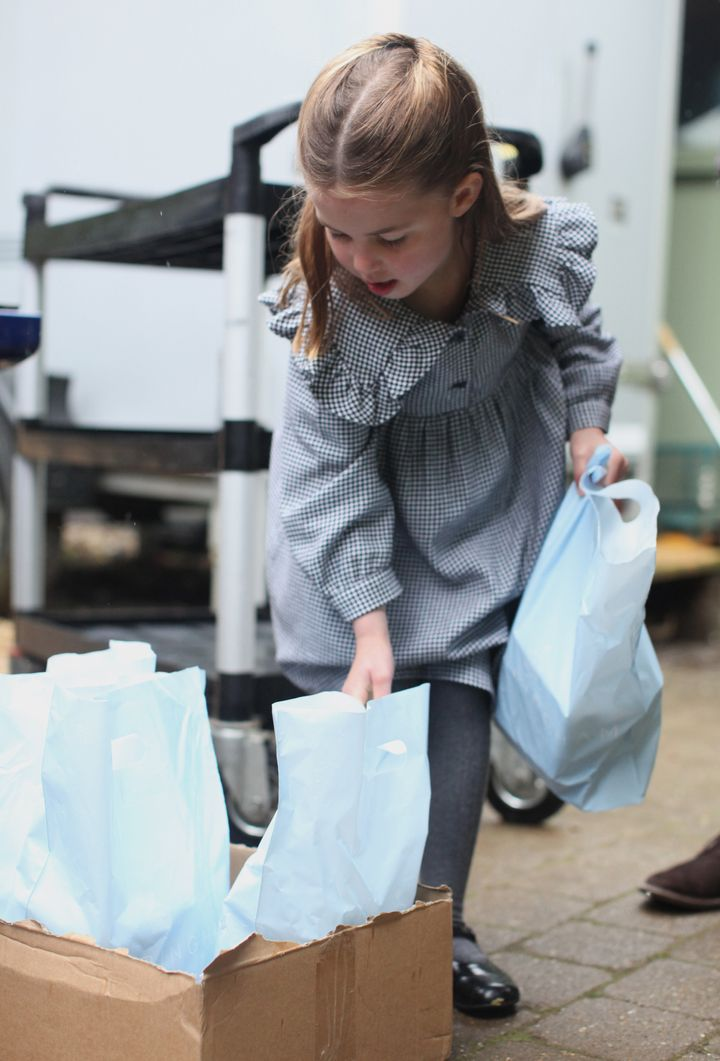 Princess Charlotte, who celebrates her fifth birthday on Saturday, helps to pack up and deliver food packages for isolated pensioners.