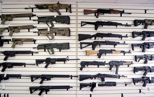 Semi-automatic rifles fill a wall at a gun shop in Lynnwood, Wash. on Oct. 2,