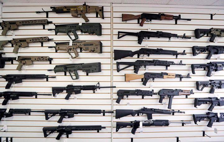 Semi-automatic rifles fill a wall at a gun shop in Lynnwood, Wash. on Oct. 2, 2018.