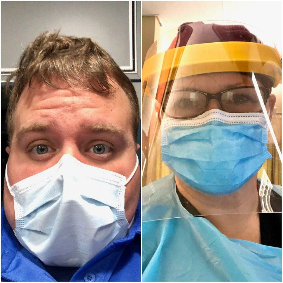 Brad Tackett (left) and Shanen Lauby are among the many health workers in parts of the U.S. sleeping away from their partners
