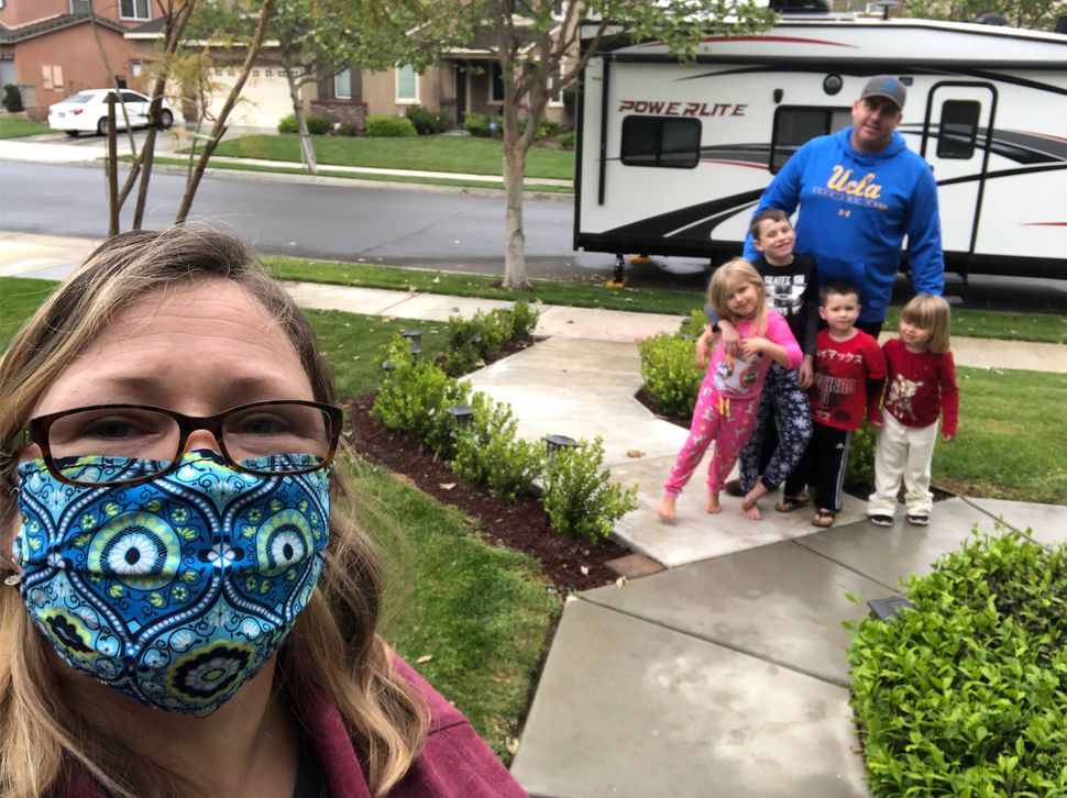 Nurse Shanen Lauby stays distant from her husband and children while she works at a California hospital during the coronaviru