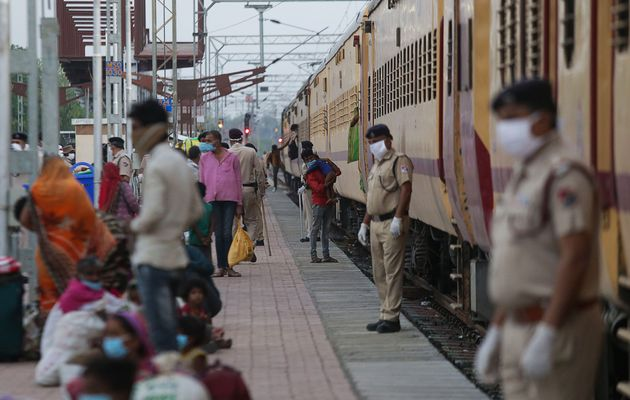 Migrant workers deboard from a special train that arrived from Nasik during lockdown, at Misrod railway...