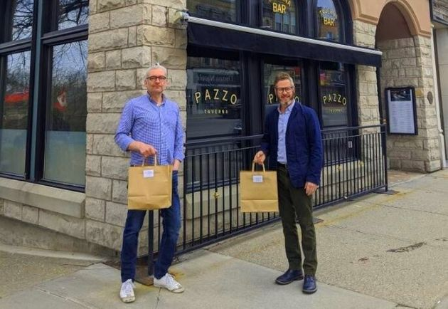 Jeff Leney (left) and Larry McCabe pose in front of Pazzo's Taverna & Pizzeria, the restaurant they...