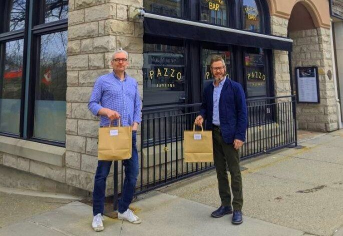 Jeff Leney (left) and Larry McCabe pose in front of Pazzo's Taverna & Pizzeria, the restaurant they run in Stratford, Ont.