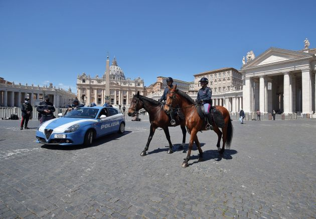 St. Peter's Square is empty due to the coronavirus pandemic during the Regina Caeli prayer time. The...
