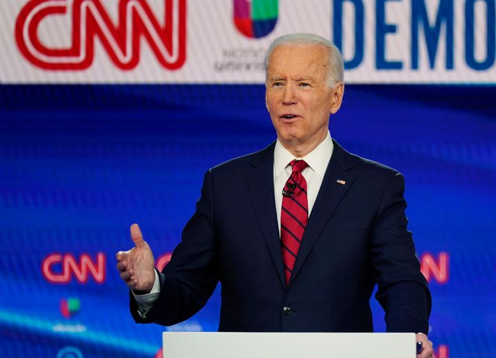 In this Sunday, March 15, 2020, photo, former Vice President Joe Biden speaks during a Democratic presidential primary debate