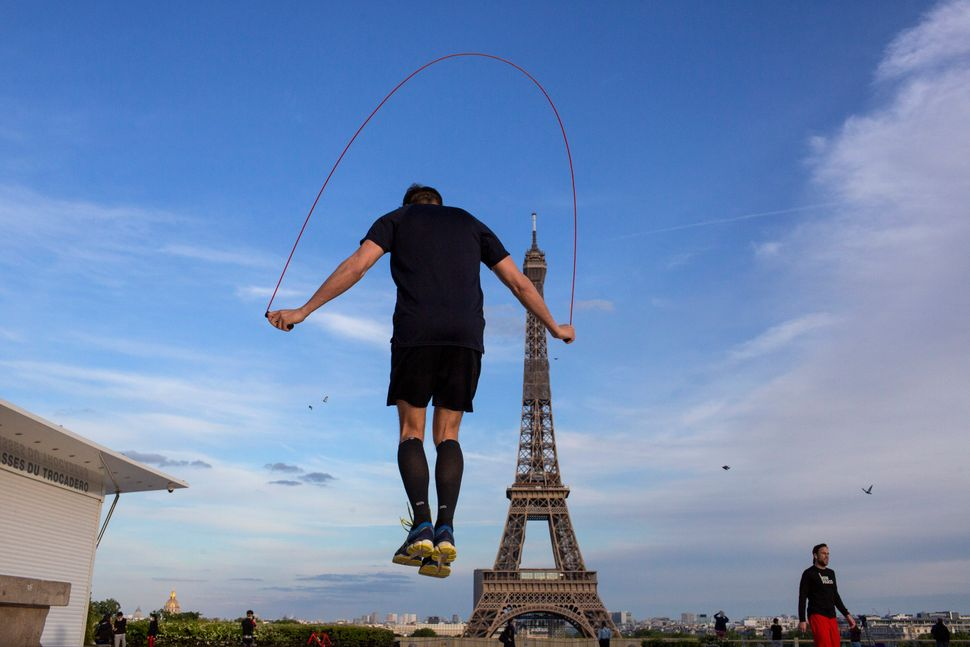 A man exercises along Trocadero Square, close to the Eiffel Tower,