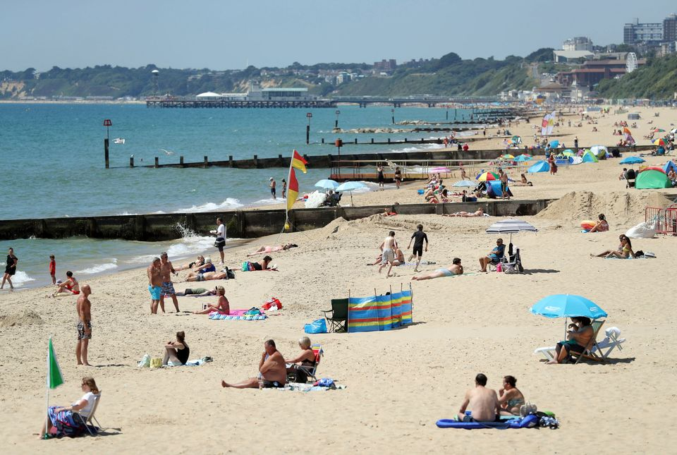 People sunbathe on Boscombe Beach in Dorset, south west England, Tuesday June 26, 2018. Temperatures peaked on Monday at 30.1C (86.2F) in Hampton in west London. (Andrew Matthews/PA via AP)