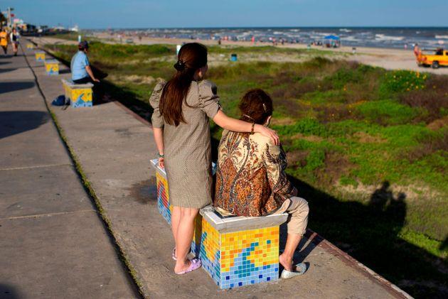 Beachgoers enjoy a day of sunshine at Galveston Beach on May 2, 2020 in Galveston, Texas, amid the coronavirus...