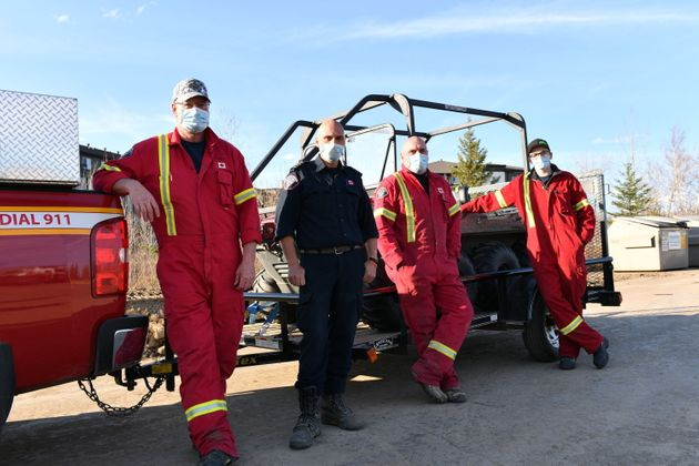 A team of firefighters from the Regional Municipality of Wood Buffalo's Saprae Creek Fire Department...