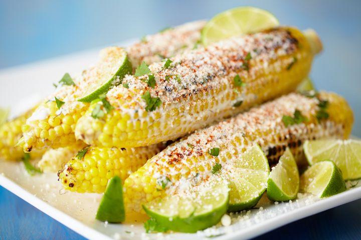 Mexican street corn on rectangular platter.