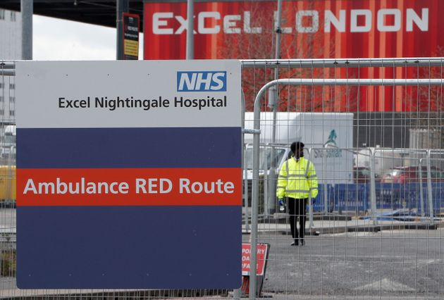 A signpost directs ambulances to the NHS Nightingale Hospital at the ExCel centre in London, Friday April...