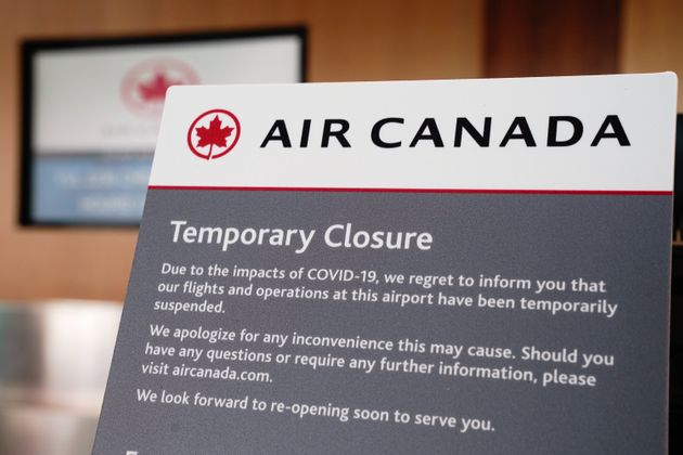 Air Canada signage appears at a ticket counter at San Diego International Airport on April 27,