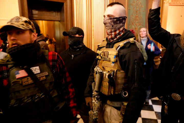 Protesters try to enter the Michigan House of Representatives chamber and are kept out by state police after the American Pat