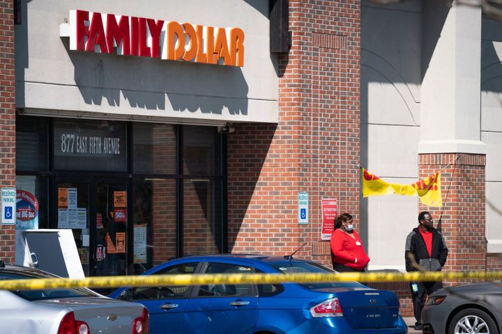 Employees stand outside the Family Dollar store in Flint, Michigan, where a security guard was killed on Friday.