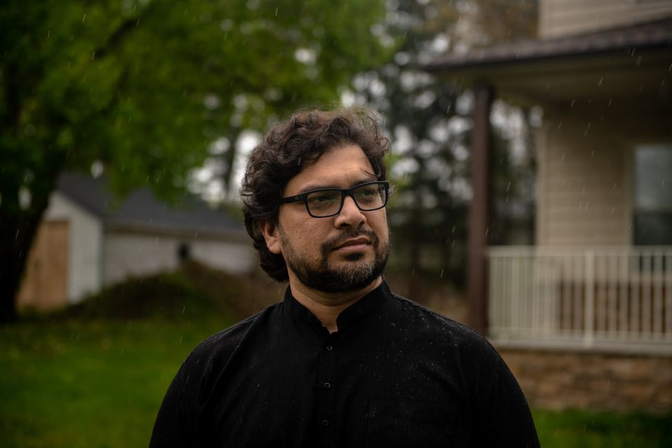 Physician Syed Raheel Hassan — in the backyard of his home in New Jersey on Thursday — knows the challenges of th