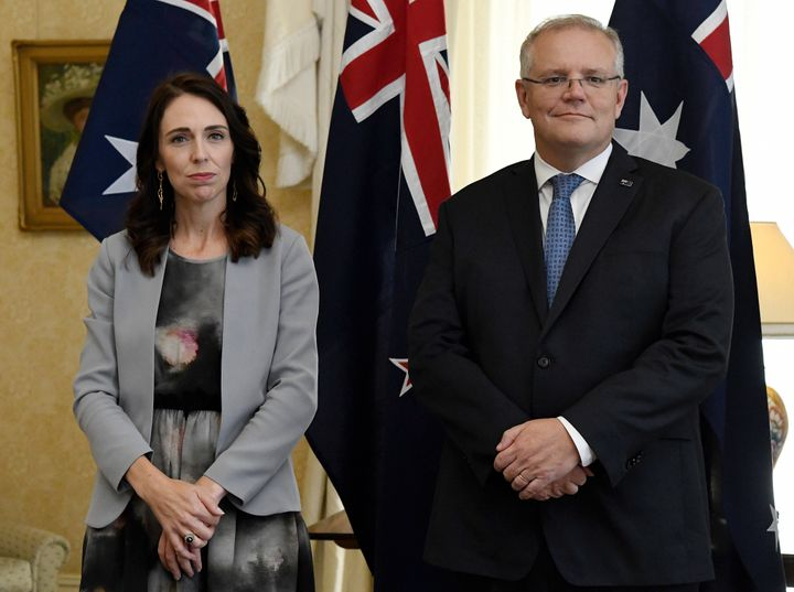New Zealand Prime Minister Jacinda Ardern, left, stands with Australian Prime Minister Scott Morrison during the signing of the Indigenous Collaboration Arrangement at Admiralty House in Sydney, Friday, Feb. 28, 2020. A (Bianca De Marchi/Pool Photo via AP)