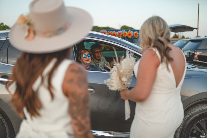 The couple greeted car-bound guests.