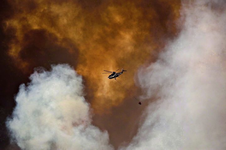 A helicopter battles a wildfire in Fort McMurray, Alta., on May 4, 2016.