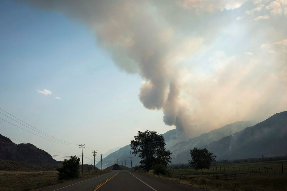 The Snowy Mountain wildfire is visible from Cawston, B.C., on Aug. 2,