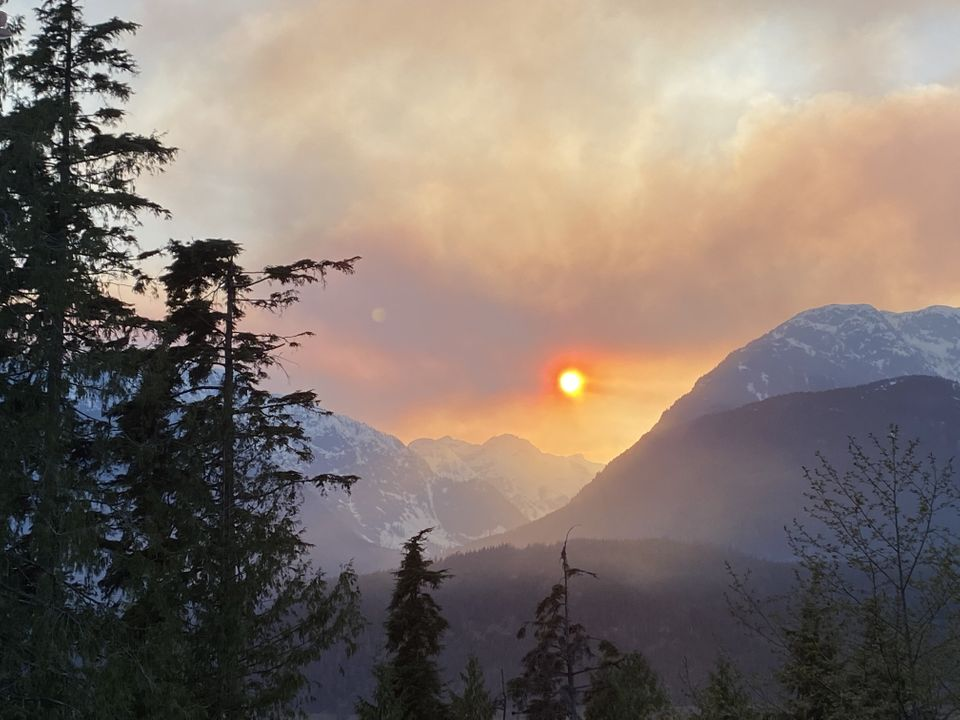 Smoke from a wildfire hangs over the mountains in Squamish, B.C., on April 15,