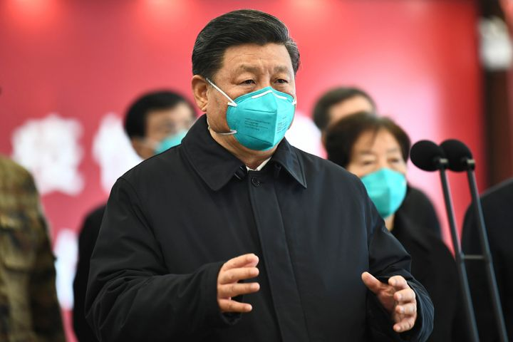 In this Tuesday, March 10, 2020, photo released by China's Xinhua News Agency, Chinese President Xi Jinping talks by video wi