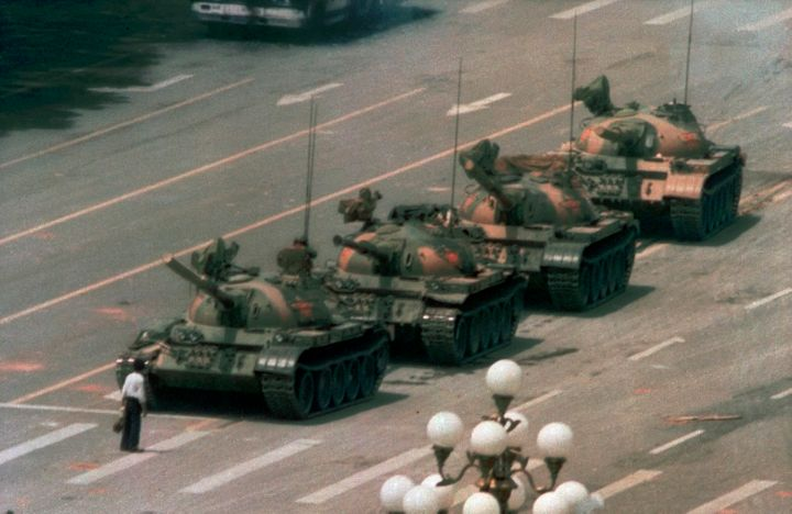 In this June 5, 1989, file photo, a Chinese man stands alone to block a line of tanks heading east on Beijing's Changan Boule