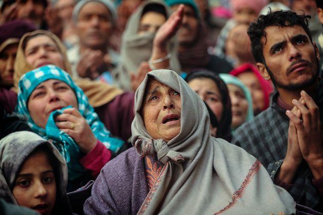 Kashmiri Muslim devotees offer prayer outside the shrine of Sufi saint Sheikh Syed Abdul Qadir Jeelani...
