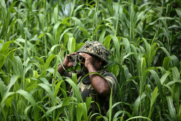 An Border Security Force (BSF) soldier keeps vigil near the India-Pakistan border at Garkhal in Akhnoor,...