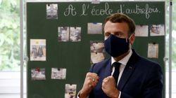 Masqué, Macron visite une école pour tenter de rassurer sur la