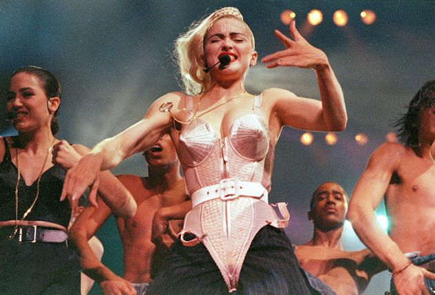 Madonna performs with her dancers during her Blond Ambition tour onJune 4,