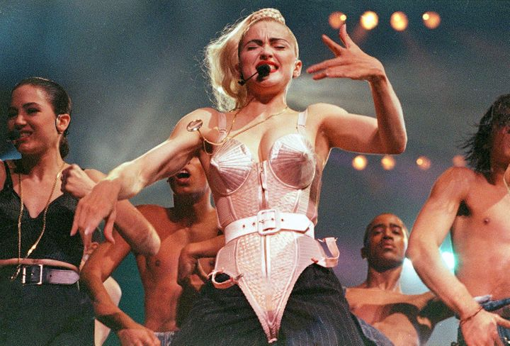Madonna performs with her dancers during her Blond Ambition tour onJune 4, 1990.
