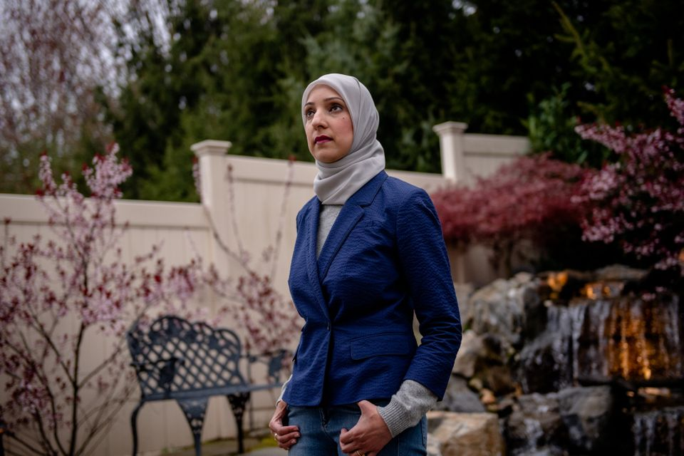 Uzma Syed — at her home on Long Island Thursday — works 16-hour shifts divided among three...