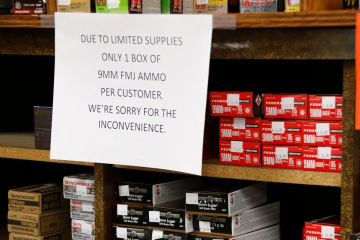 Signs point out quantity limits on certain types of ammunition after Dukes Sport Shop reopened, Wednesday, March 25, 2020, in
