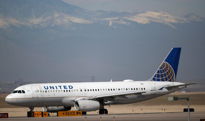A United Airlines jetliner taxis down a runway for takeoff from Denver International Airport. The airliner has asked employee