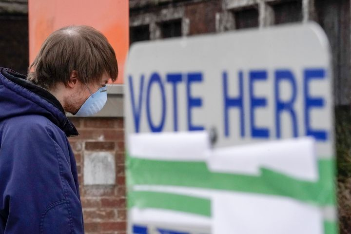 A voter in Milwaukee arrives at a polling place for Wisconsin's controversial April 7 primary election, held despite concerns