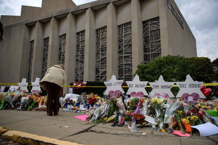 Mourners visit the memorial outside the Tree of Life Synagogue on Oct. 31, 2018, in Pittsburgh. Eleven people were killed in