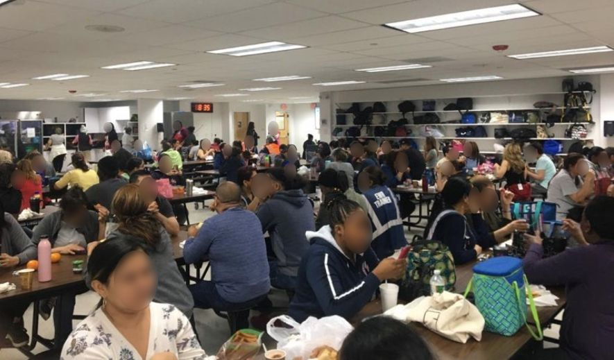 Photos and videos provided to HuffPost show Secaucus warehouse employees sitting side-by-side without gloves or masks in the midst of the pandemic.