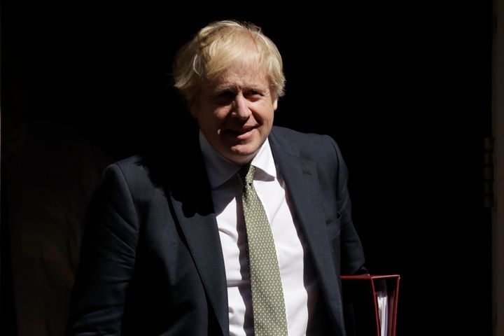 <strong>British Prime Minister Boris Johnson leaves 10 Downing Street in London, to attend his first weekly Prime Minister's