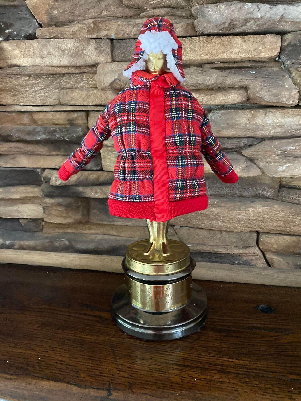 """Mercedes Ruehl's Oscar in its """"winter wardrobe."""""""