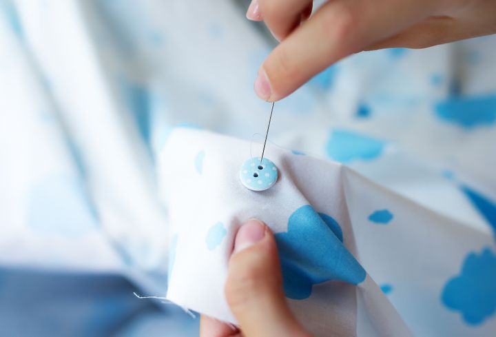 One of the mending tasks that might be the best project for beginners is learning how to hand sew a button back on when it pops off.