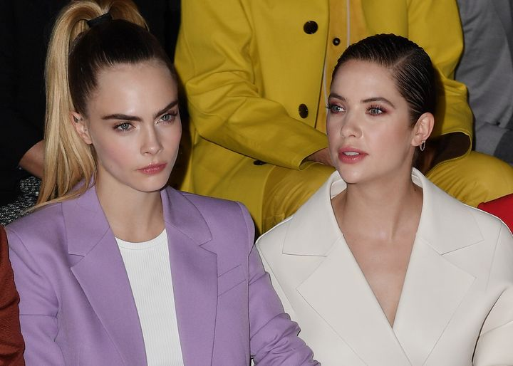 Cara Delevingne and Ashley Benson attend the Boss fashion show in February 2020.