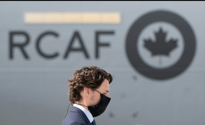 Prime Minister Justin Trudeau attends a repatriation ceremony for the six Canadian Armed Forces members killed in a helicopter crash off of Greece during Operation Reassurance, at CFB Trenton, Ont. on May 6, 2020.