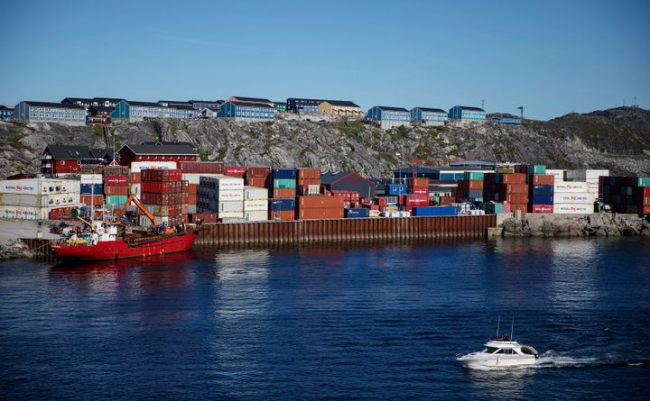 Containers are stacked at a port in Nuuk on July 29, 2017. Cargo ships sailing through the Northwest Passage could potentiall