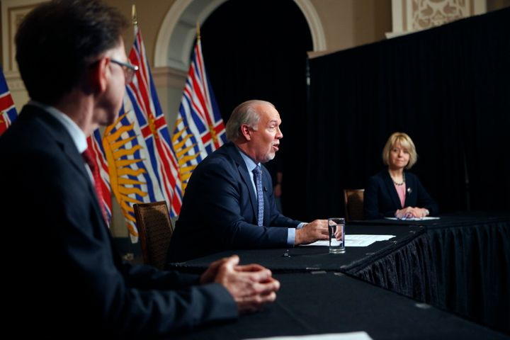 Premier John Horgan is joined by chief public health officer Dr. Bonnie Henry and Health Minister Adrian Dix as they discuss reopening the province's economy in phases in response to the COVID-19 pandemic during a press conference in Victoria, B.C., on May 6, 2020.