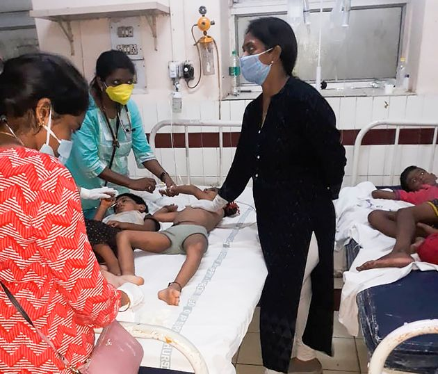 Staff attend to children affected by a gas leak from an LG Polymers plant at the King George hospital...